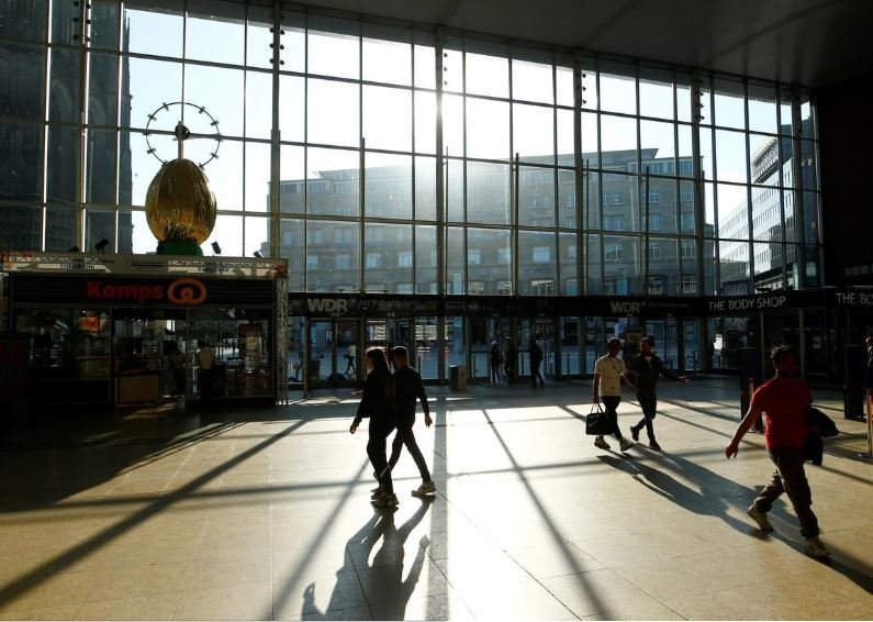 people walk through the main railway station of cologne as the spread of the coronavirus disease covid 19 continues in cologne germany photo reuters