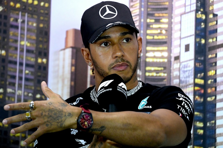 british driver was linked with a move to ferrari after the six time world title winner revealed in january photo afp