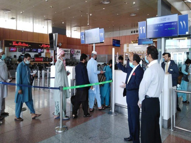 umrah pilgrims arrive at the jeddah airport to board a special flight to multan on april 18 photo courtesy pakistan consulate general in jeddah