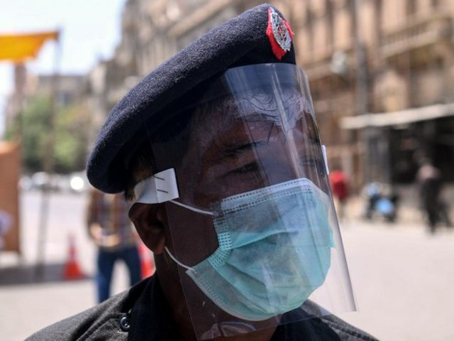 Officials performing duties without PPE are vulnerable to virus.  PHOTO: AFP/FILE