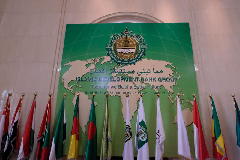 A Banner with arabic countries flags are seen at the entrance of the Islamic Development Bank Group in Jeddah, Saudi Arabia. PHOTO: REUTERS
