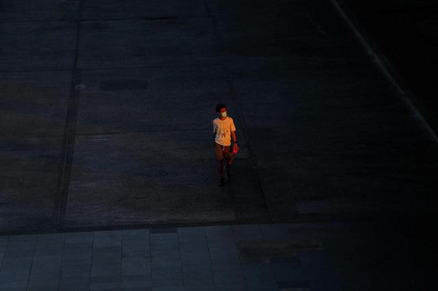 a man wearing a protective face mask walks on a street during the coronavirus disease covid 19 outbreak at talad thai wholesale market outside bangkok thailand april 21 2020 photo reuters