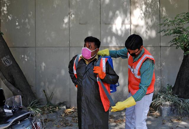 i do feel afraid indian workers disinfect coronavirus hotspots