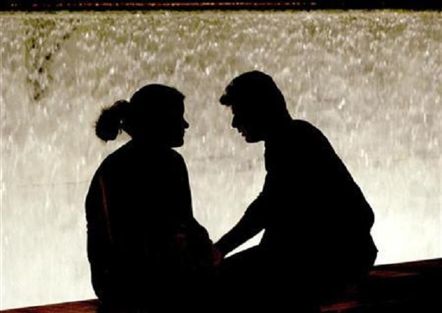 a file photo of a couple sitting in front of a fountain in athens 039 syntagma square august 5 2004 reuters john kolesidis