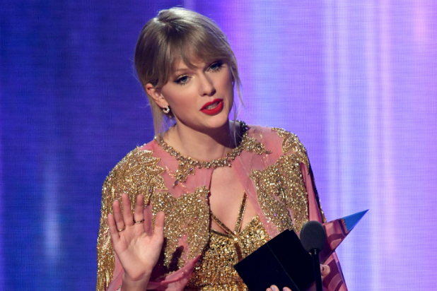 tasteless taylor swift labels release of old songs shameless greed