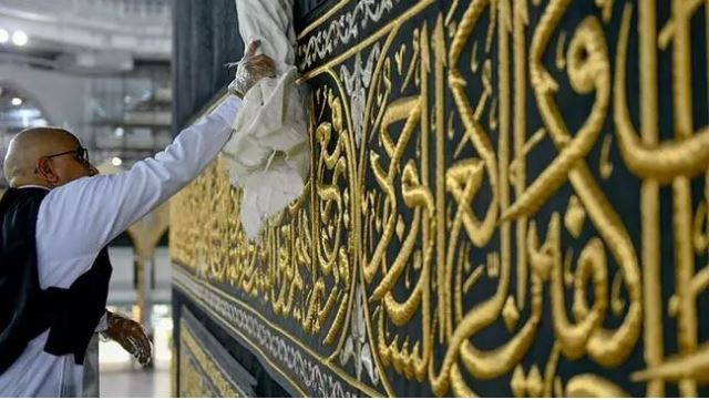 A worker cleans and sterilises the Kaaba, following the outbreak of the coronavirus disease (COVID-19), ahead of the Ramazan, in the Grand mosque in the holy city of Mecca, Saudi Arabia. PHOTO: REUTERS