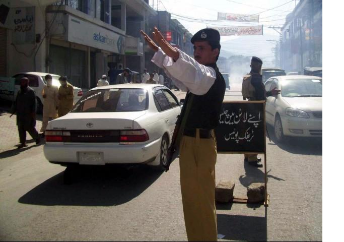 a traffic warden directs traffic photo file