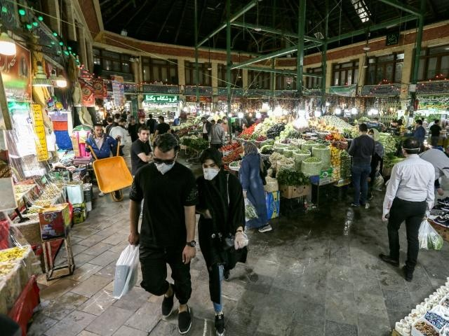 shoppers clad in protective gear including face masks and latex gloves walk through tajrish bazaar in iran 039 s capital tehran at the start of the muslim holy month of ramazan photo afp