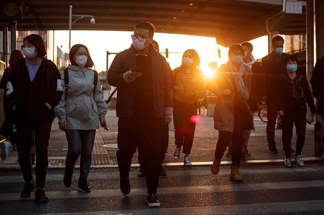 people wear protective masks as they leave work during evening rush hour in beijing as the spread of the novel coronavirus disease covid 19 continues china april 20 2020 photo reuters