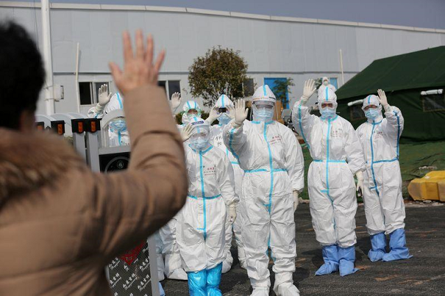 medical personnel in protective suits wave hands to a patient who is discharged from the leishenshan hospital after recovering from the novel coronavirus in wuhan the epicentre of the novel coronavirus outbreak in hubei province china march 1 2020 photo reuters