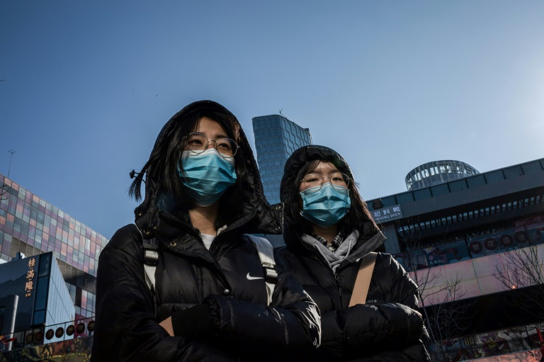 chinese girls wear protective masks in beijing on january 23 2020 photo afp
