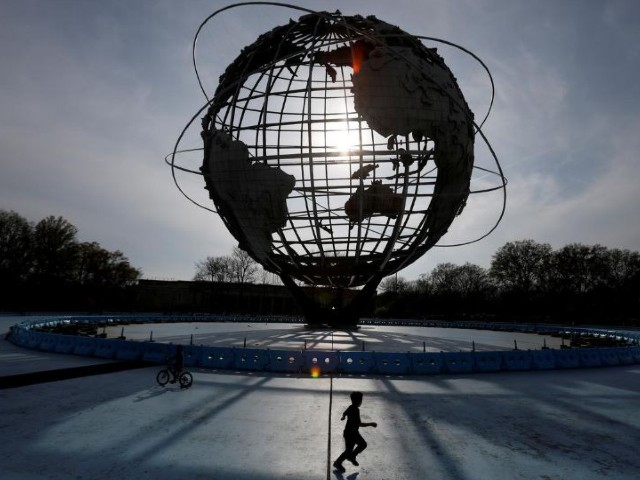 a child plays under the unisphere in flushing meadows corona park during the outbreak of the coronavirus disease covid 19 in the queens borough of new york city us photo reuters file