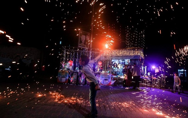 a palestinian boy waves a homemade sparkler firework as he celebrates ahead of the holy fasting month amid concerns about the spread of the coronavirus disease covid 19 in the southern gaza strip photo afp file