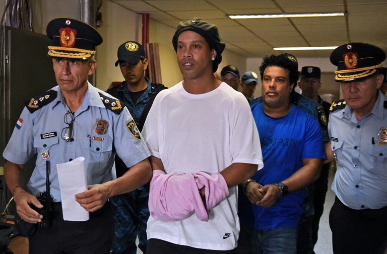 ronaldinho and his brother roberto de assis moreira are accused of entering paraguay in possession of false passports photo afp