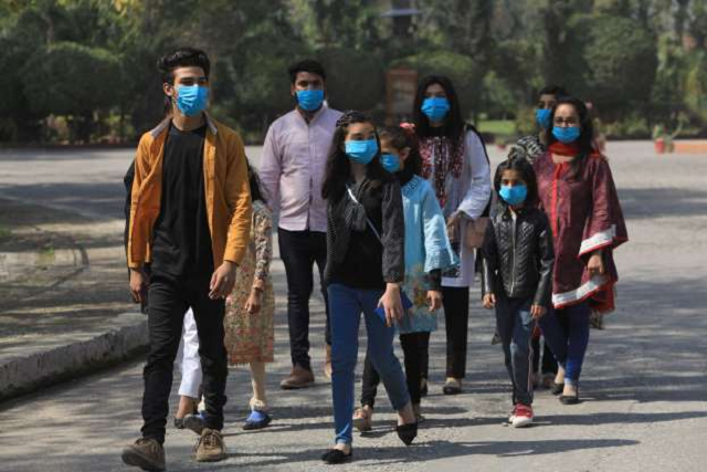 volunteers wear masks as a preventive measure against the coronavirus as they walk during an awareness compaign by a ngo at the premises of the st john cathedral in peshawar photo reuters