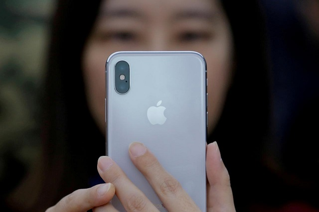 an attendee uses a new iphone x during a presentation for the media in beijing china october 31 2017 photo reuters