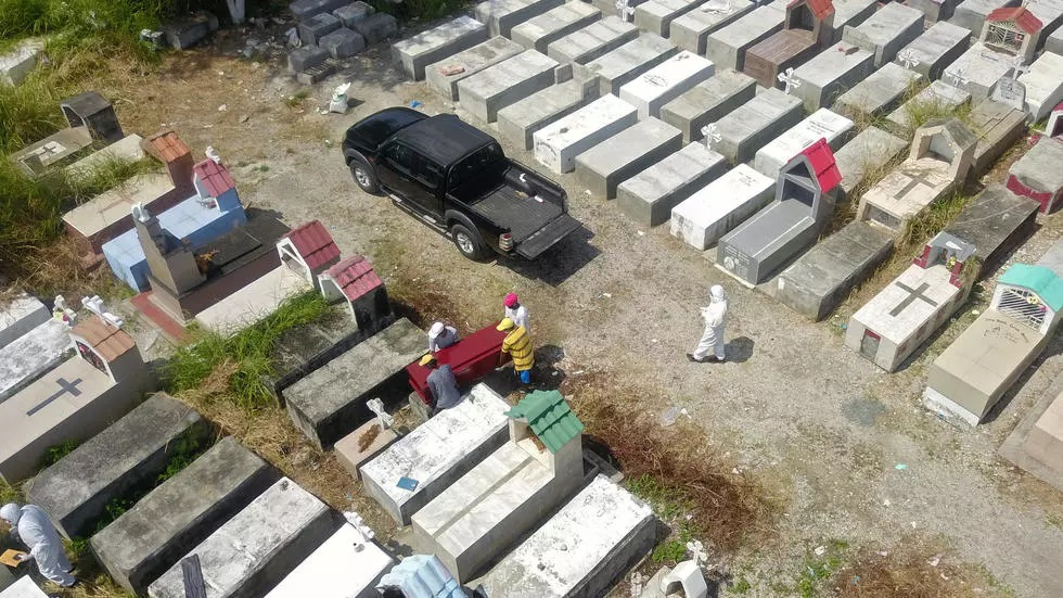 emergency workers at a cememtery in guayaquil ecuador photo afp