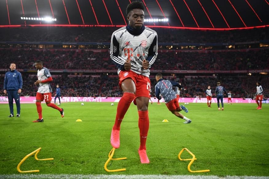 bayern star ex refugee davies raises funds for those forced to flee