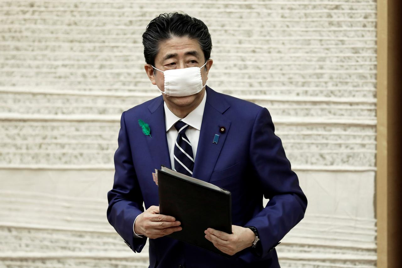 japan s abe says impossible to hold olympics unless pandemic contained