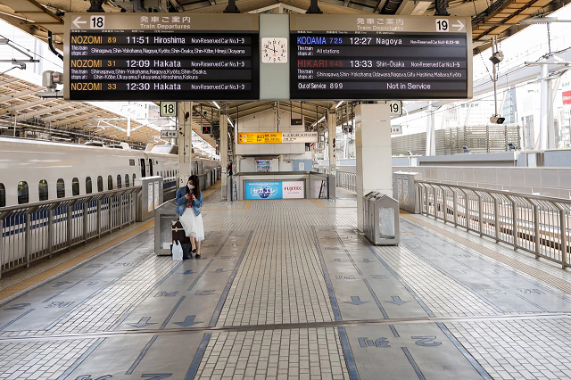 a passenger wearing a face mask waits for a train on an almost empty platform of tokyo station where fewer people than usual are seen during golden week holidays following the coronavirus disease covid 19 outbreak in tokyo japan april 29 2020 photo reuters