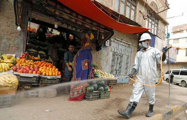 a health worker wearing a protective suit disinfects a market amid concerns of the spread of the coronavirus disease covid 19 in sanaa yemen april 28 2020 photo reuters