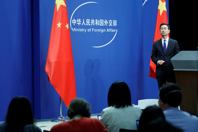 chinese foreign ministry spokesperson geng shuang and journalists attend the daily press briefing of the foreign ministry in beijing china march 18 2020 photo reuters