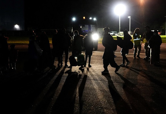 Passengers repatriated from Afghanistan, disembark from an RAF Airbus KC2 Voyager aircraft, after landing at RAF Brize Norton, southern England. Photo: AFP