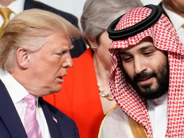US President Donald Trump speaks with Saudi Arabia's Crown Prince Mohammed bin Salman during a family photo session with other leaders and attendees at the G-20 leaders summit in Osaka, Japan. PHOTO: REUTERS/FILE