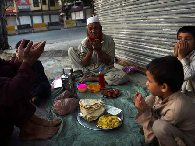 A man prays before breaking his fast in the holy month of Ramazan in Karachi. PHOTO: AFP/FILE