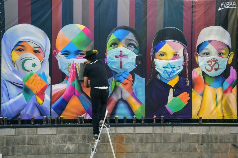 true to kobra 039 s style 039 co existence 039 is a work of vibrant colours it depicts five children from different continents each representing on of the world 039 s five major religions photo afp