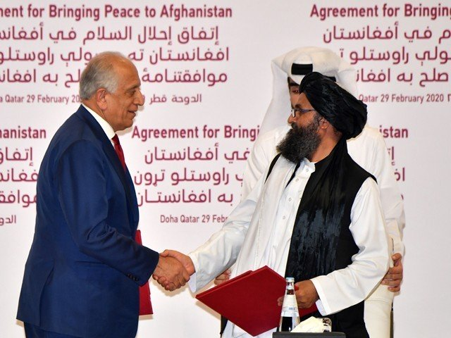 us special representative for afghanistan reconciliation zalmay khalilzad left and taliban co founder mullah abdul ghani baradar shake hands after signing a peace agreement during a ceremony in the qatari capital doha on february 29 2020 photo afp