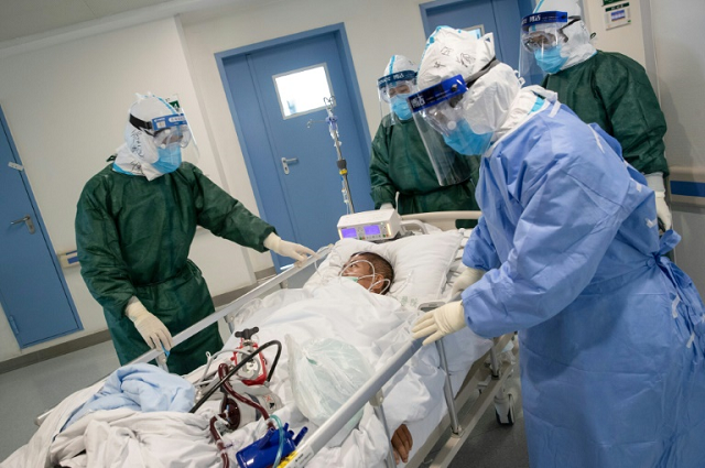 with staff increasingly affected hospitals struggle to provide care to patients photo afp file