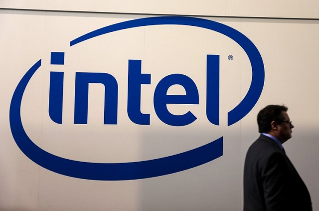 a visitor passes an intel logo at the mobile world congress in barcelona spain february 26 2018 photo reuters