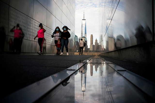 people visit the empty sky memorial as the the one world trade center in new york is seen from liberty state park after many new jersey parks set to re open during the outbreak of the coronavirus disease covid 19 in jersey city new jersey us may 2 2020 reuters