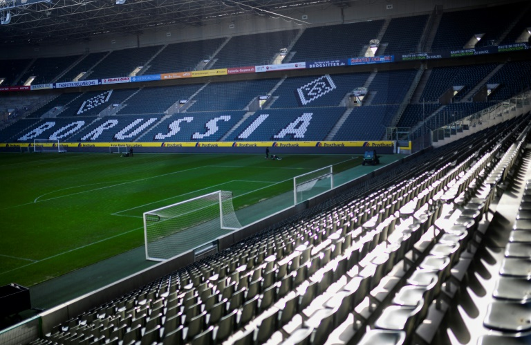 chancellor angela merkel will meet the 16 heads of the german states with the restart of the bundesliga photo afp