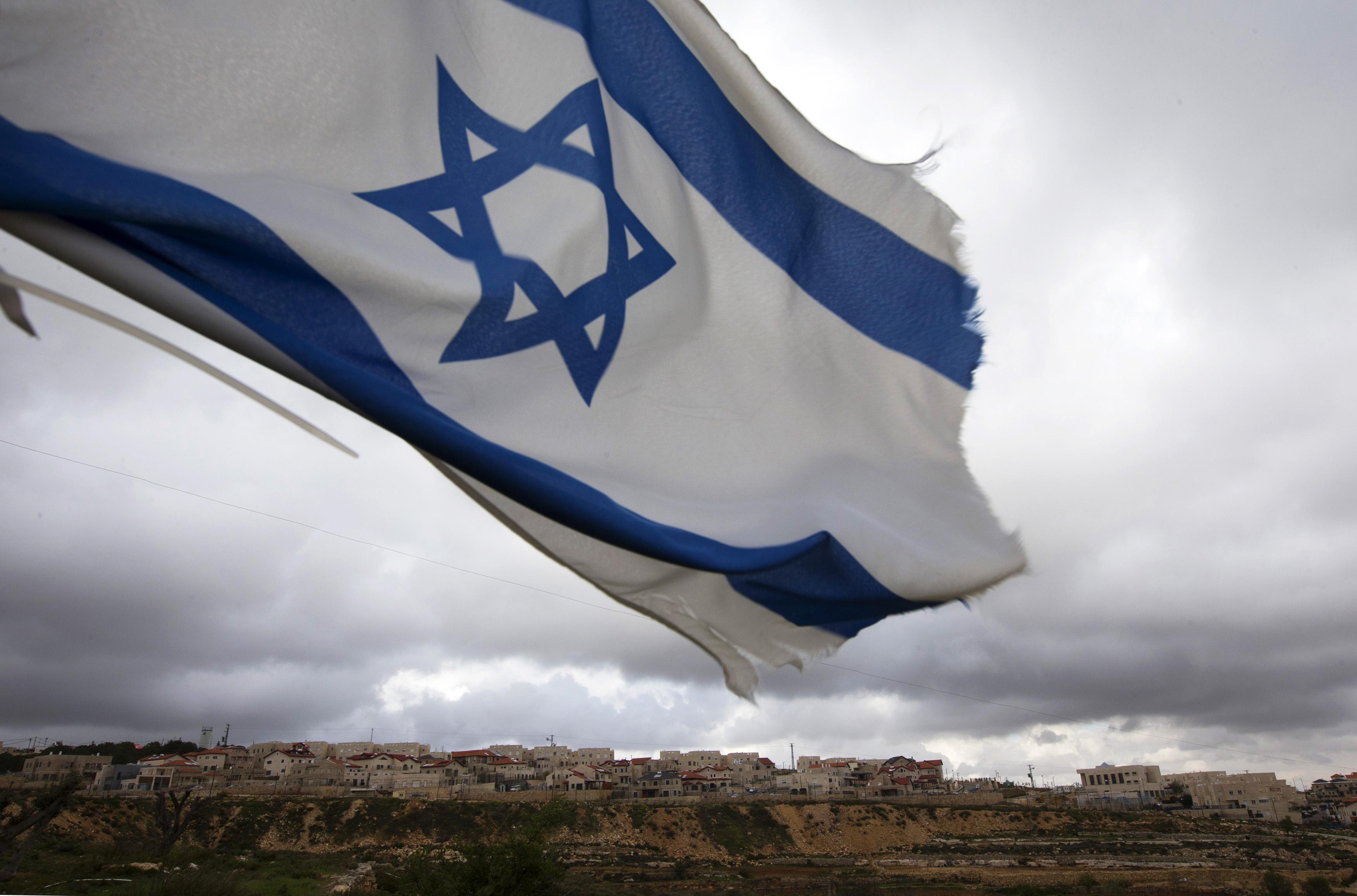 an israeli flag flies on a hill near the west bank photo reuters