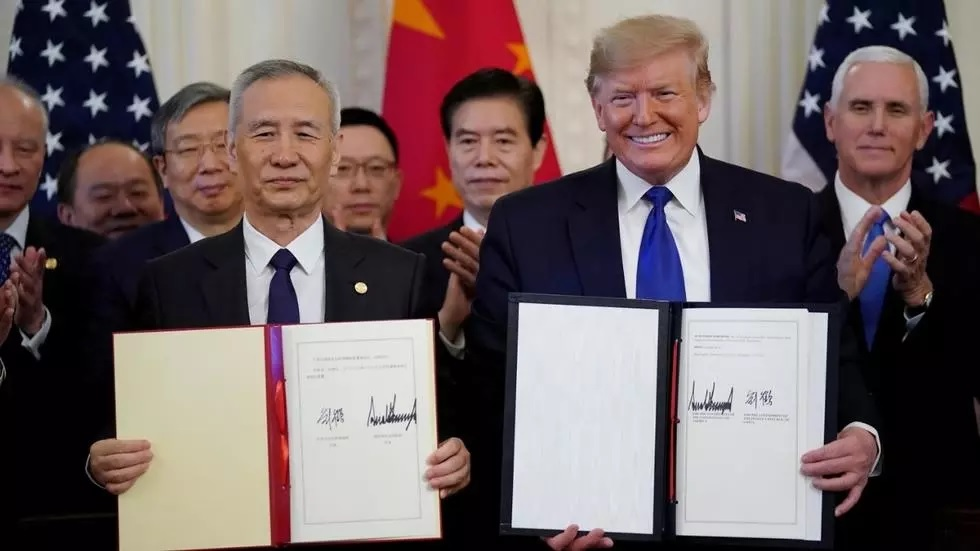 us president donald trump stands chinese vice premier liu he after signing quot phase one quot of the us china trade agreement in the east room of the white house in washington photo reuters