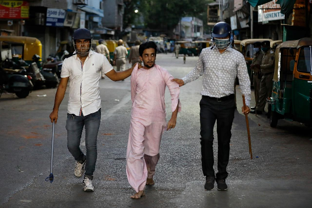 plainclothes policemen detain a man during clashes after police urged the residents to remain indoors during an extended lockdown to slow the spreading of the coronavirus in ahmedabad india photo reuters