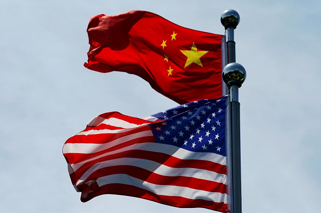 chinese and us flags flutter near the bund in shanghai china july 30 2019 photo reuters