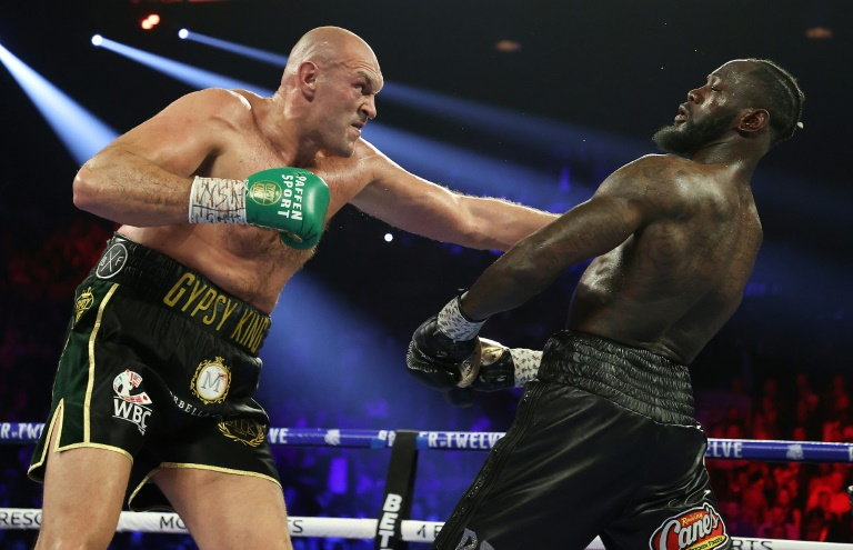 Fury got his hands on one of the four major world belts again when he ended Wilder's long reign as champion, knocking the previously unbeaten American down twice on the way to a seventh-round stoppage in February. PHOTO: AFP