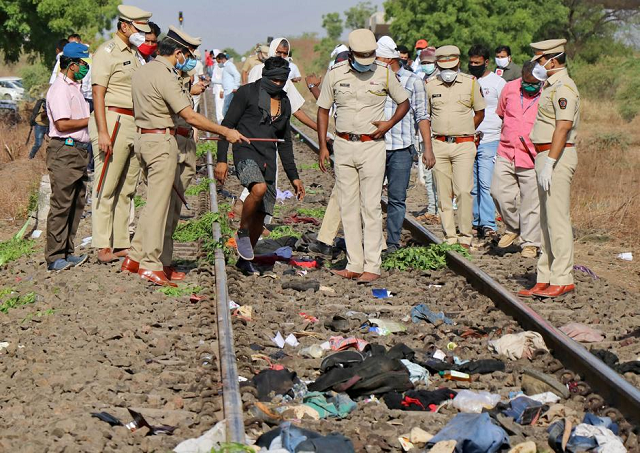 police officers examine the railway track after a train ran over migrant workers sleeping on the track in aurangabad district in the western state of maharashtra india may 8 2020 photo reuters