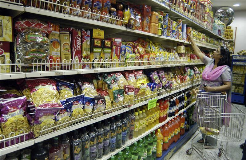 a woman shops in a grocery store photo reuters