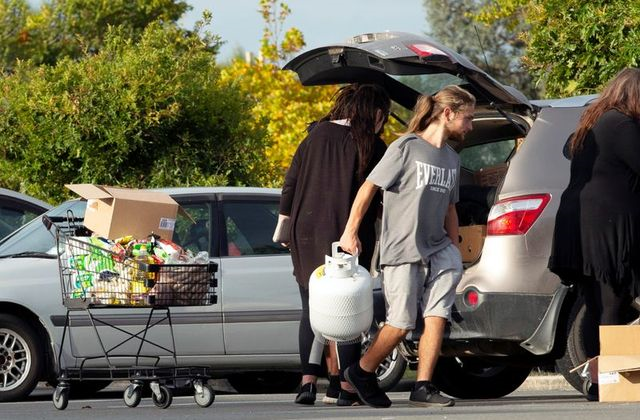 people take out products from their supermarket shopping cart and load them into their car outside pak 039 nsave supermarket amid the spread of the coronavirus disease covid 19 in christchurch new zealand march 23 2020 photo reuters