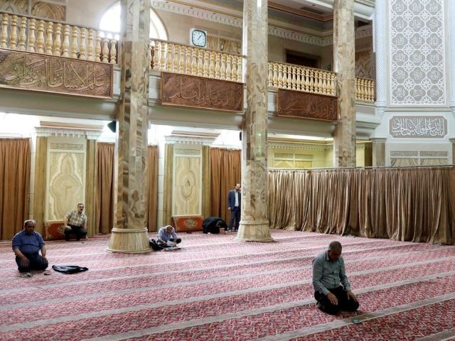 iranian worshippers pray as they keep social distancing at a mosque following the outbreak of the coronavirus disease covid 19 in tehran iran photo reuters file
