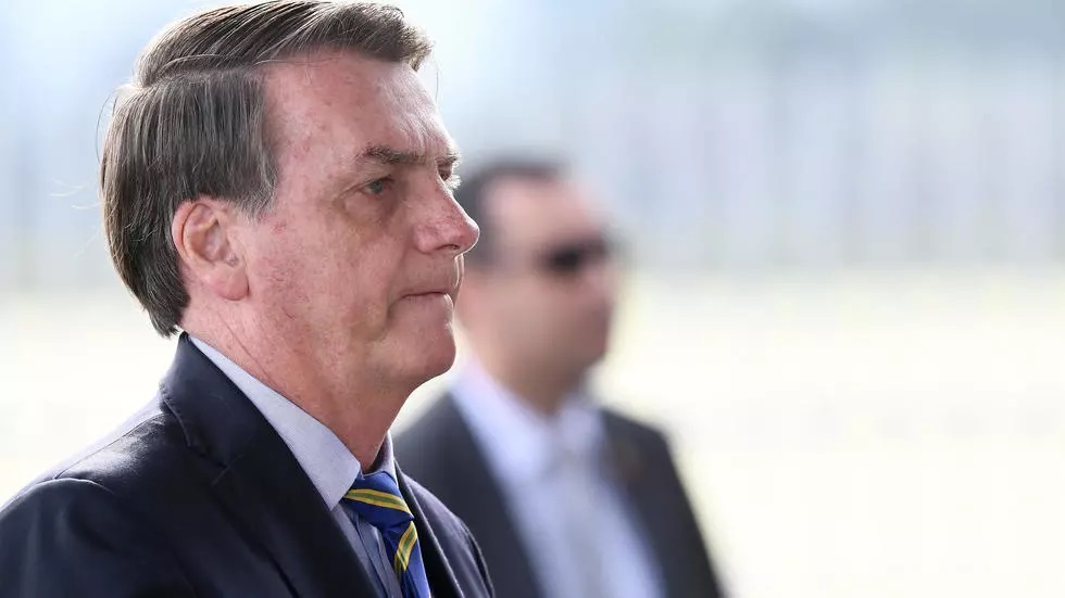 brazilian president jair bolsonaro 039 s pictured may 6 2020 criticism of stay at home measures to fight the virus has put him at odds with state and local authorities across brazil not to mention his own former health minister photo afp