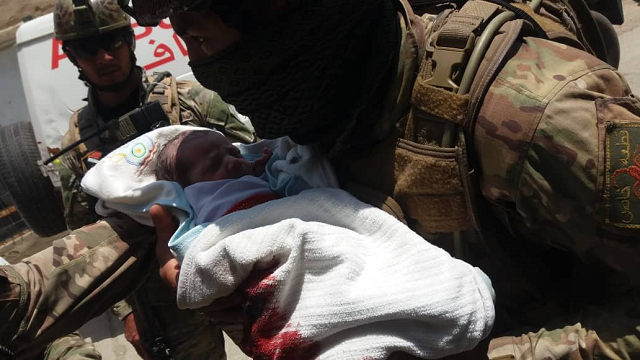 security forces rescuing a newborn baby from hospital under attack in kabul photo tolo news