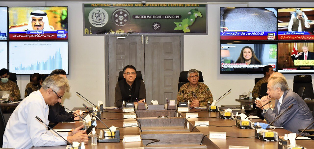 planning minister asad umar is chairing a national command and operation centre ncoc meeting in islamabad photo pm office