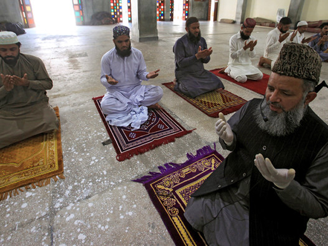 Worshippers maintain safe distance as they attend Friday prayer in Lahore. PHOTO: REUTERS/FILE