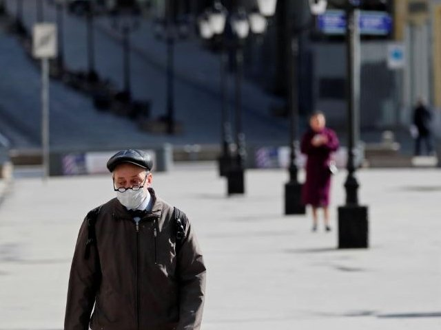 a man wearing a protective face mask walks along the street as the spread of the coronavirus disease covid 19 continues in moscow russia photo reuters