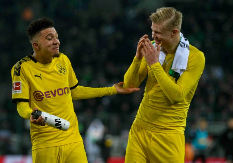 dortmund are looking to close the four point gap behind leaders bayern munich who visit union berlin on sunday photo afp